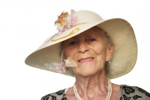 elderly woman with fashionable hat